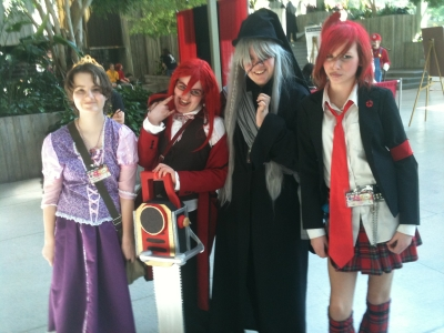 In The Middle My Daughter Neve Gray Wig And Friend K Holding Giant Chainsaw Cosplaying Undertaker Grell Respectively From Kuroshitsuji