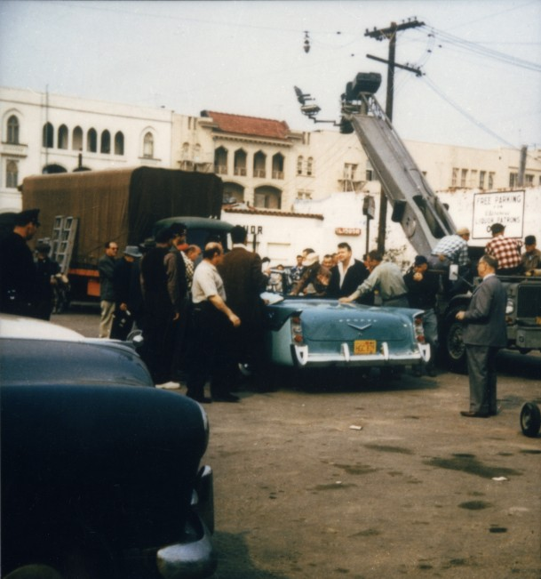 Orson Welles and others during production of TOUCH OF EVIL, 1958.