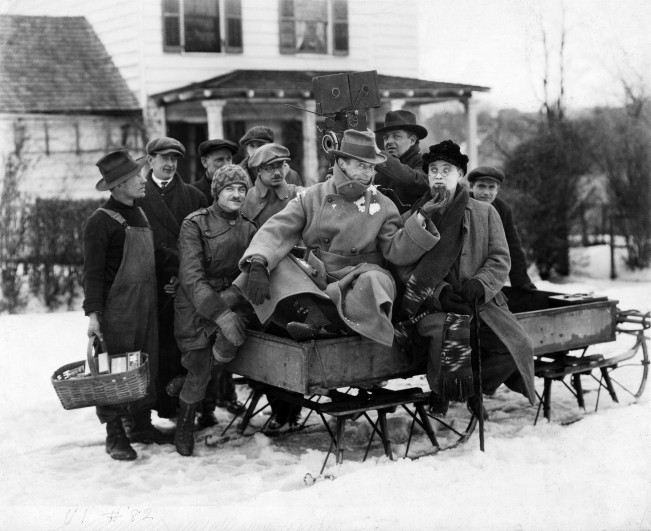 (Pictured) D.W. Griffith and others during production of WAY DOWN EAST, 1920.